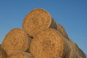 round bales of straw stacked on top of each other
