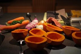 peeled pumpkin and vegetables on the table in the kitchen