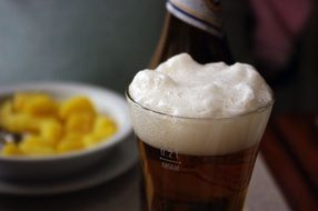 potatoes and a glass of foam beer