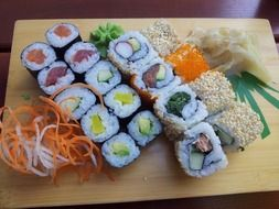 Sushi is a dish with rice and seafood