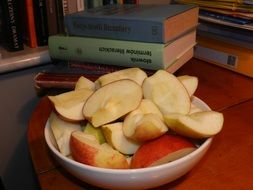 sliced apple in a white plate
