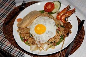 Mie goreng with fried egg and prawns