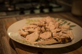 grilled pieces of chicken meat on plate
