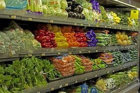 racks with vegetables in the supermarket
