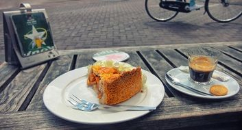 cake and coffee on wooden table outdoor, netherlands, amsterdam