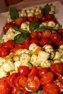 mozzarella cheese and tomatoes lie in a pile