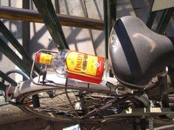 empty bottle of booze on a bicycle