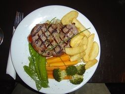 meat steak with potatoes and vegetables
