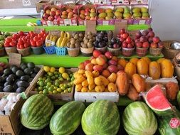 watermelons and fruits on farmers market