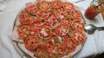 pizza with red tomatoes on a plate