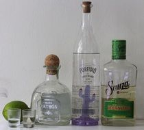 alcoholic drinks in different glass bottles