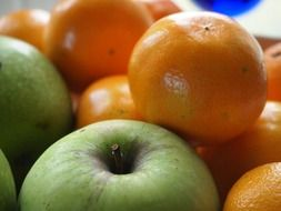 green and yellow fruits, apples and clementines