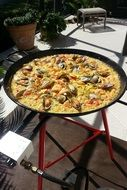 spanish paella on the pan outside