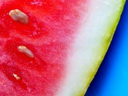 Pink watermelon with white seeds in the section