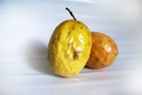 two yellow passion fruit