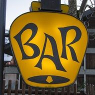 yellow sign for a bar