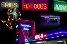 night neon signs hot dogs