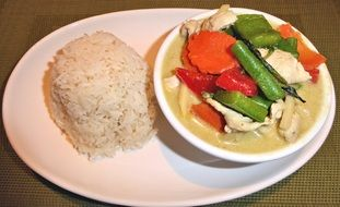 rice with curry chicken and vegetables plate