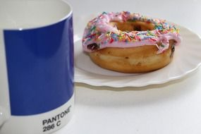 breakfast, blue mug and donut on table