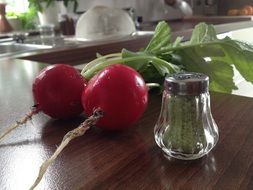 two red radishes on the table