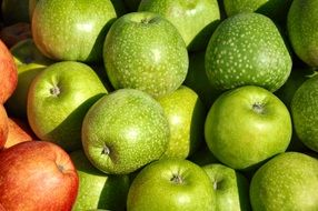 crop of green and red apples