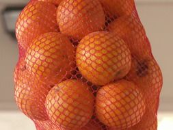 oranges in a large grid close-up