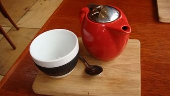 red teapot and striped cup