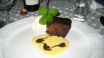 chocolate cake decorated with cream and mint