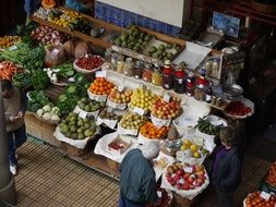 People at a fruit market in Madeira, Portugal