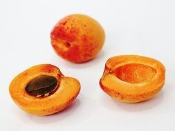 two apricot halves and ripe apricot