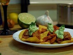 chips with garlic sauce and green lime