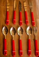 cutlery with red handles