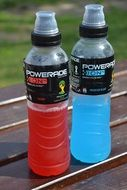 two bottles with isotonic drink