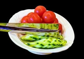 tomatoes and cucumbers on a plate