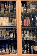 bottles of alcohol in the cupboard