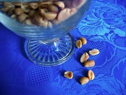 salted nuts in a glass plate