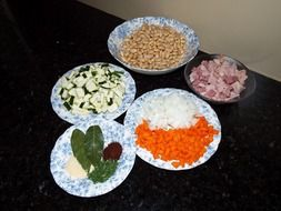 raw vegetables, spices, beans and meat for soup
