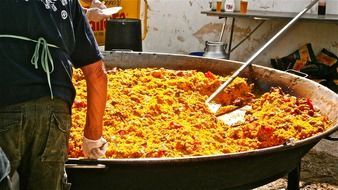 Spanish paella in a huge frying pan
