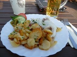 fried potatoes on a white plate