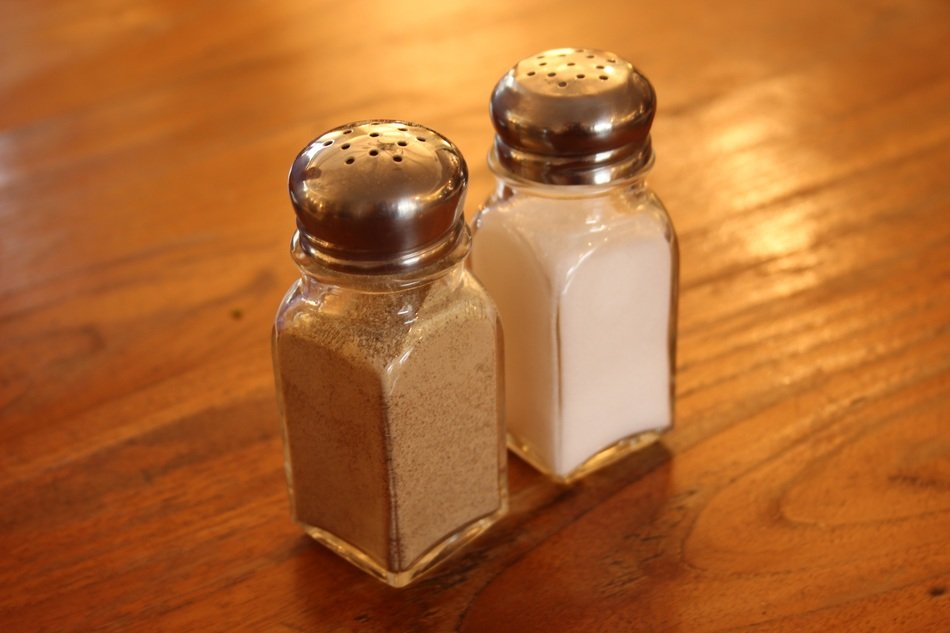 glass salt and pepper shaker on a wooden table