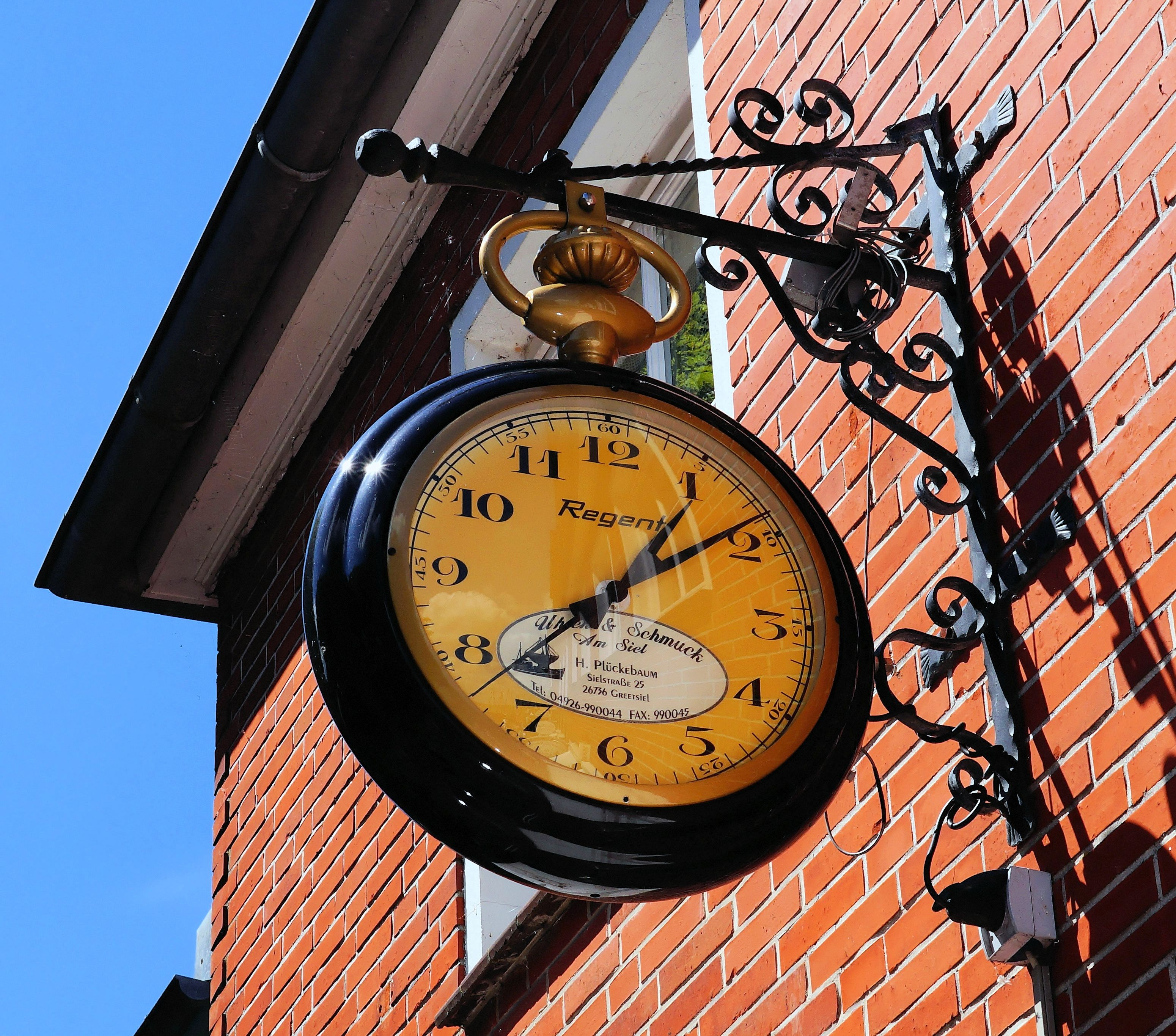 mechanical clock decorate exterior of the house free image