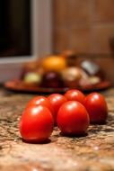 small red tomatoes on the table