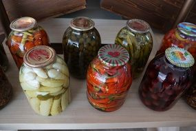 jars of vegetables are on the shelf