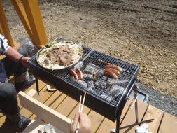 grilled sausages and barbecue on the nature
