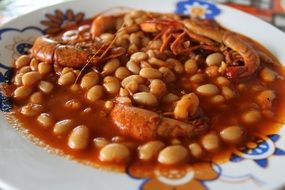 mexican dish with beans and shrimp