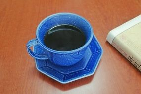 black coffee in a blue cup