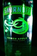 bottle of vodka with a green apple