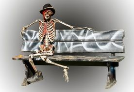 creepy skeleton wearing a hat and sitting on a bench