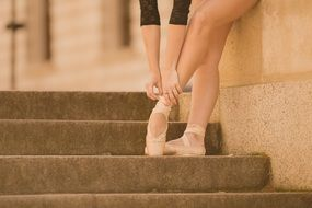 ballet dancer white pointe shoes in stairs