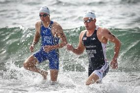 athlete swimmers on a competion at the beach